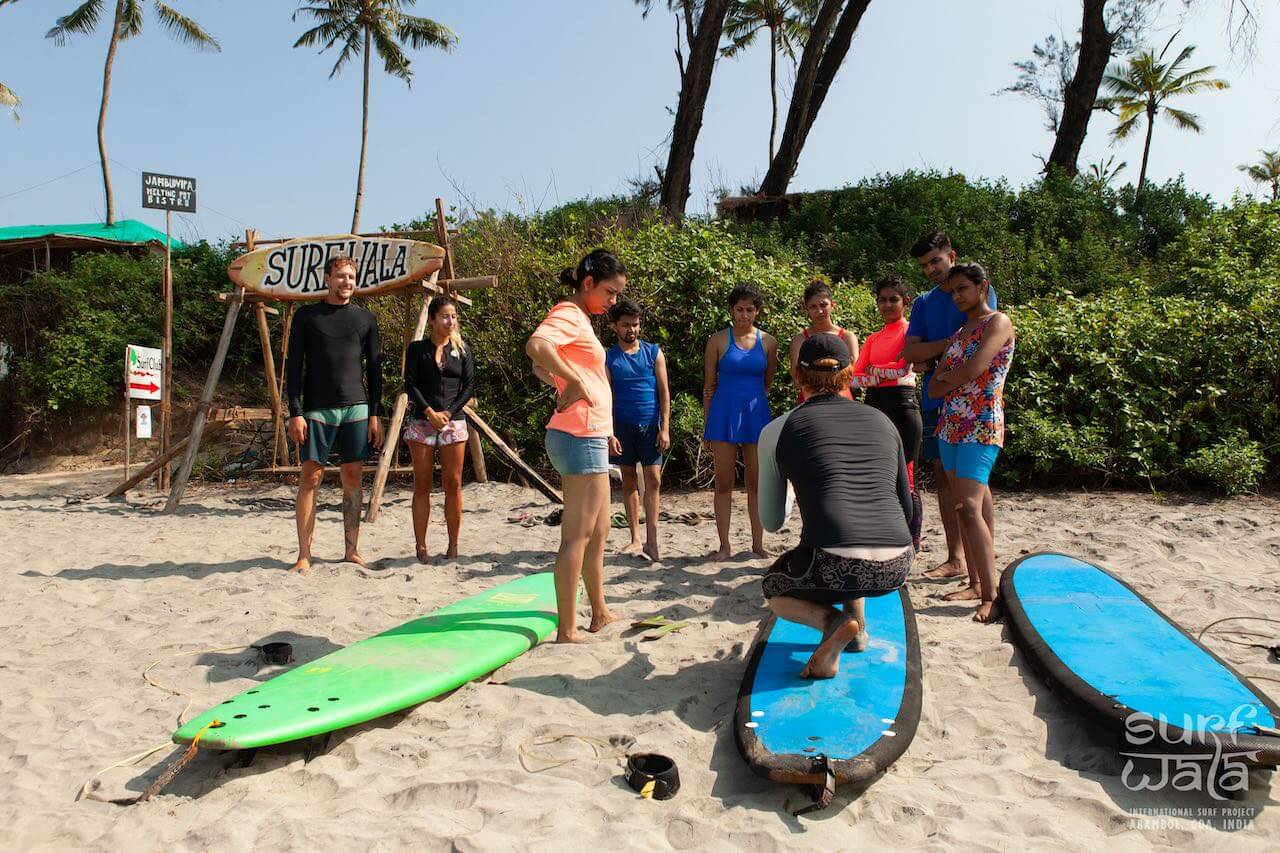 Our surf instructor giving a demonstration to a group surfing lesson